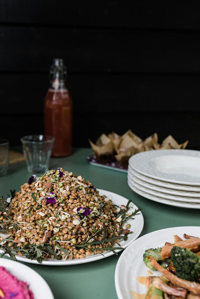 Spelt Salad and vegan dishes on a zinc table prepared by Chef Naturelle