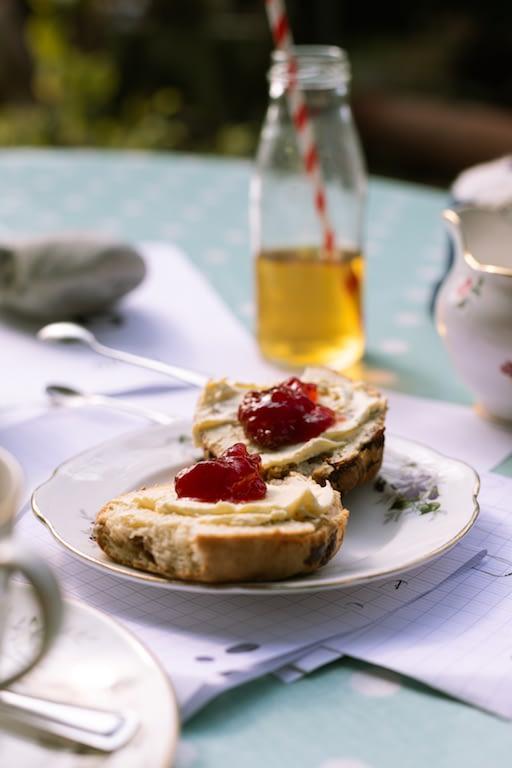 Afternoon tea and apple juice on table outside