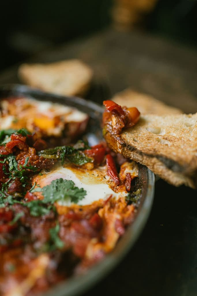 Shakshuka a tomato based dish with eggs and sourdough bread.