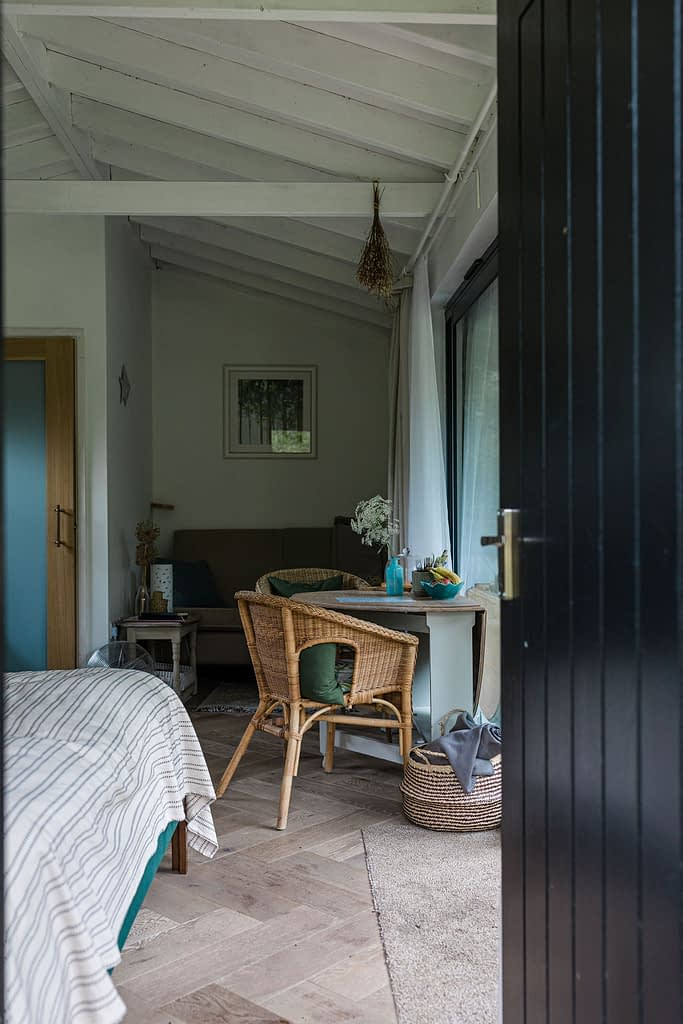 Interiors of a cabin by natural pool in Cambridgeshire