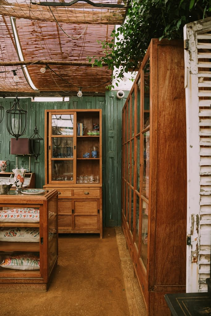 shop floor with vintage cupboards full of objects