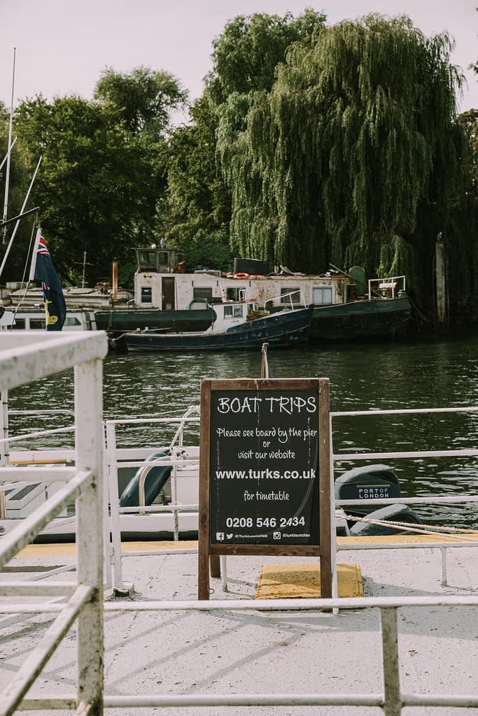Blackboard with Boat trips by the river