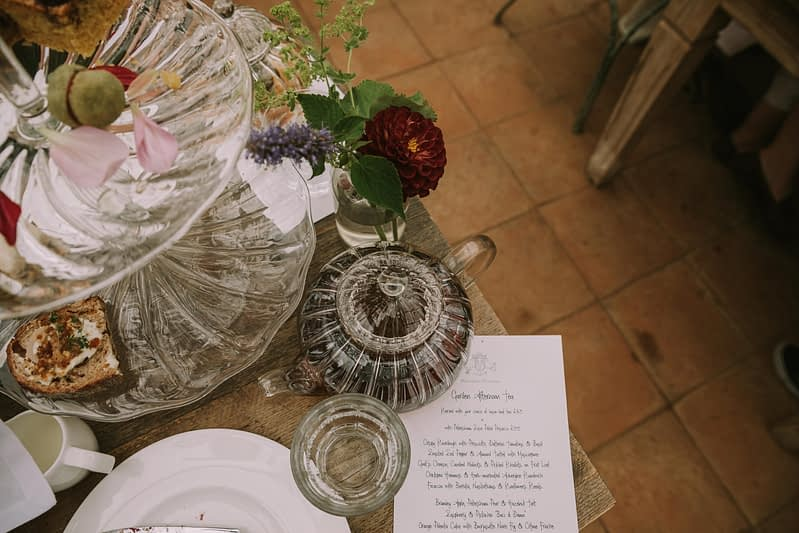Glass teapot and glass cake stand for afternoon tea