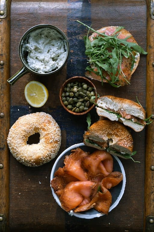 Overhead shot of ingredients of smoked trout bagel