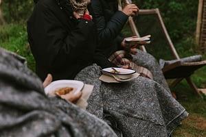 Outdoor porridge breakfast under blankets