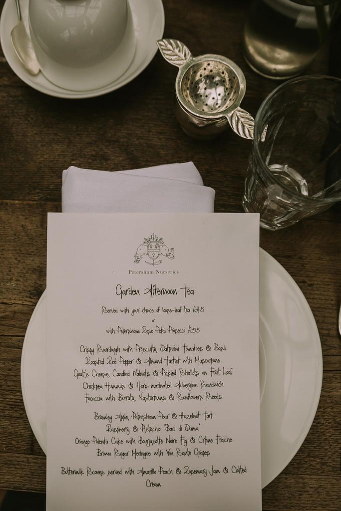 Calligraphy afternoon tea menu on table