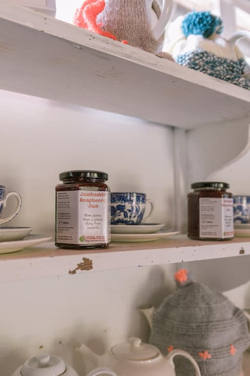 Jars and teapots on shelves