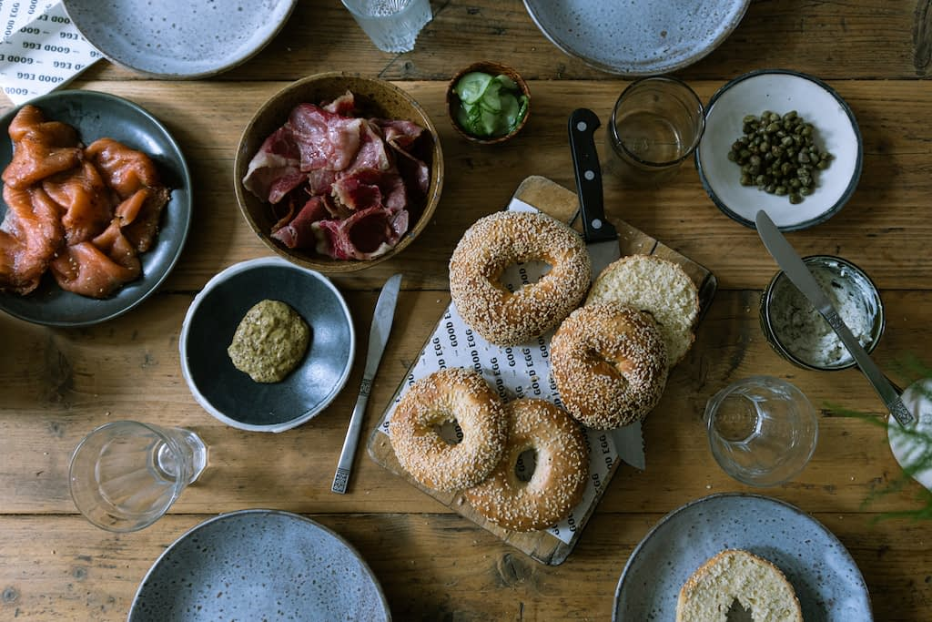 Overhead shot of a table ready for brunch with bagels