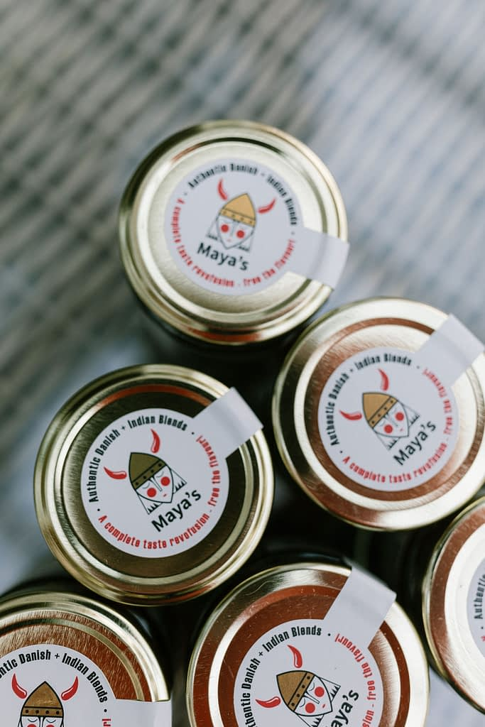 top with stickers of chilli sauce jars